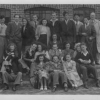 Top row (left-right), Jerzy Hirschberg, Michael Preston, Elsa Federbush Stern, Henry Abish, ?  Leo Frischman, ? (second from right) Arthur Poznanski.  Middle row, ?, Nat Wald, Edith Buxbaum Frydman, Paul Gast, ? Evelyn Woolf Zylberszac, ?  Bottom row middle is Ben Helfgott.  Primrose Club, London.